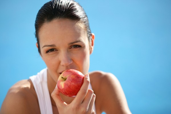 Extraction - Woman biting an apple
